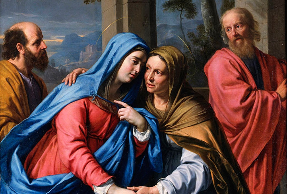 Mary and Elizabeth embrace with two men in the background