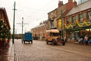 Old village with antique cars on a cobblestone road