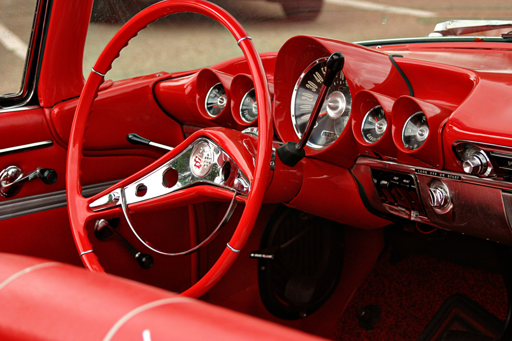 Steering wheel in a red convertible