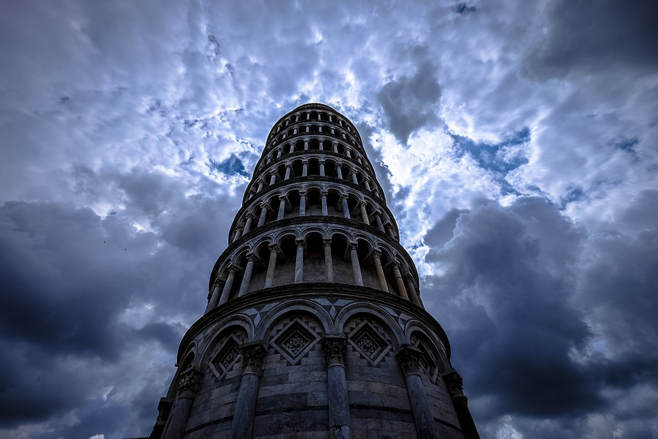 A tower reaching up to a cloudy sky