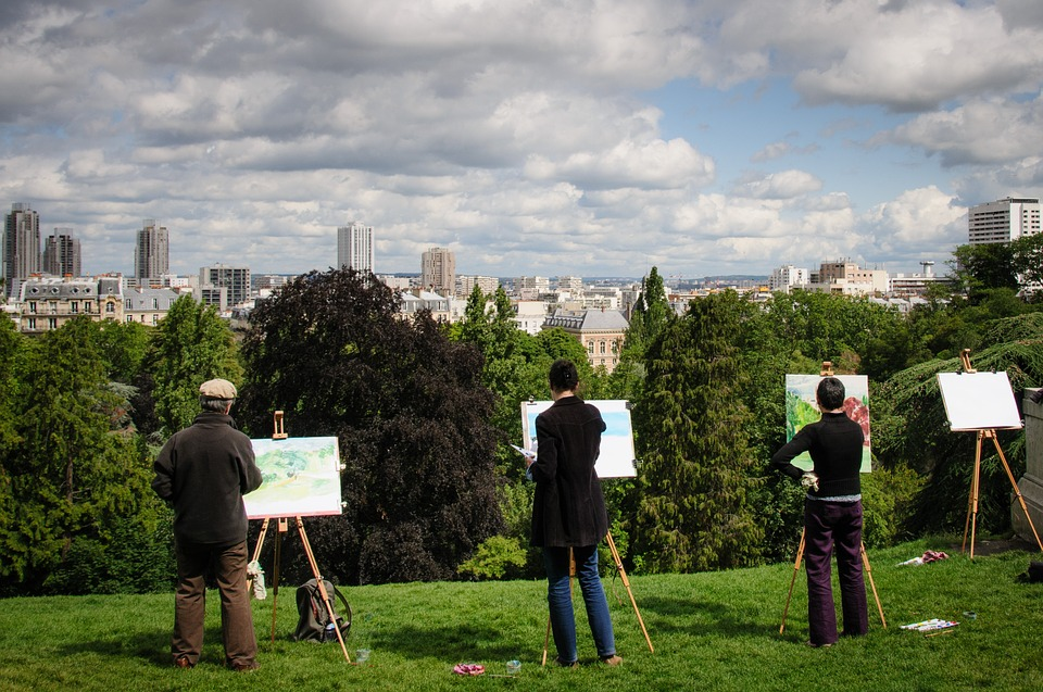 Plein air painters overlooking city