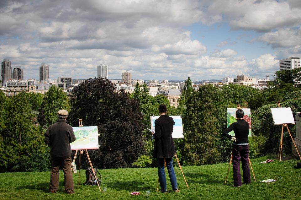 Plein air painters overlooking city