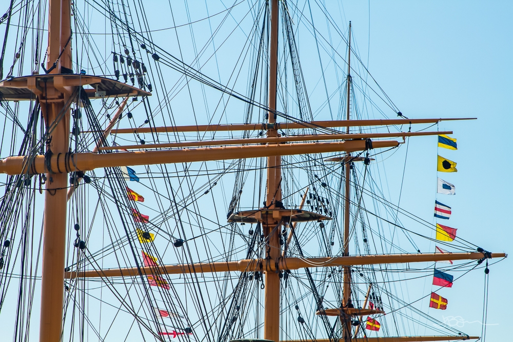 Boat masts with rigging and flags