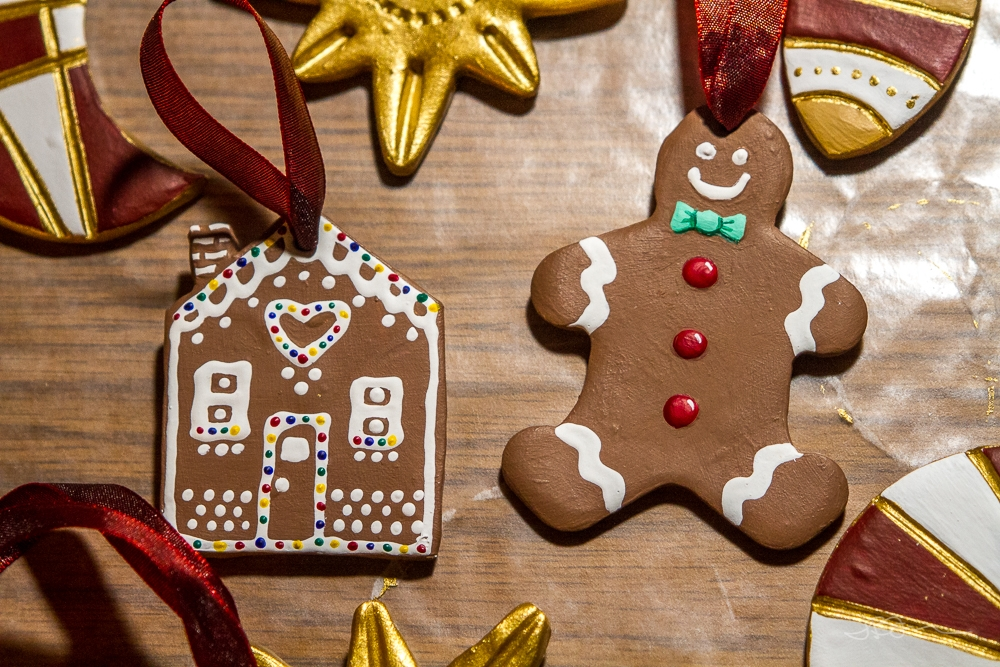Gingerbread house and gingerbread man Christmas tree ornaments