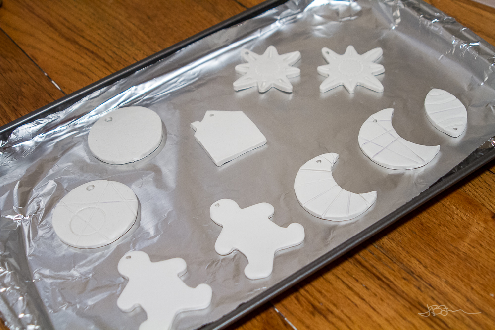 DIY Christmas Tree Ornaments on a foil-lined baking sheet