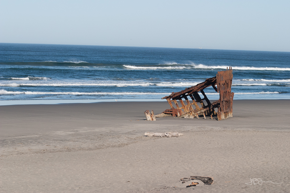 Remains of a shipwreck on the beach at Fort Stevens State Park