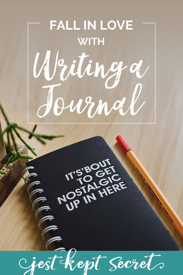 "Black journal with pen and potted plant with title ""How to Fall in Love with Writing a Journal"""
