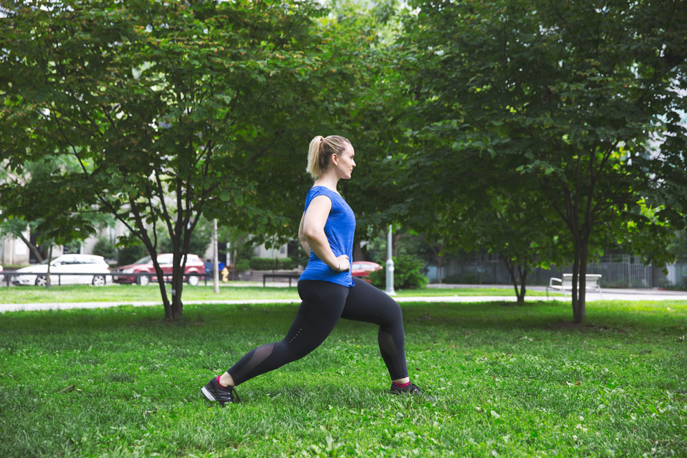 Girl stretching in a park