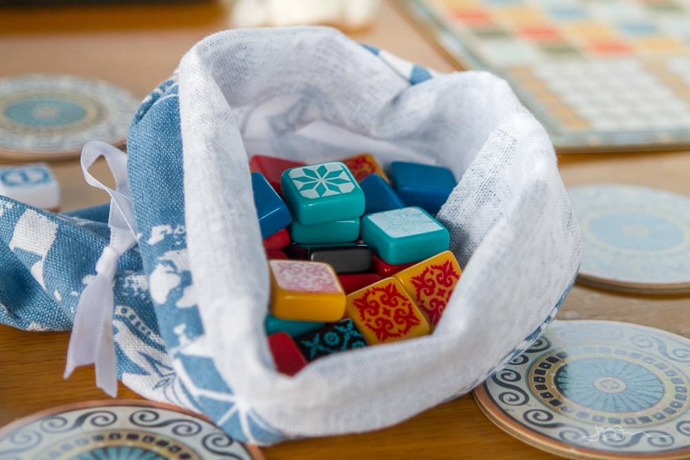 Colorful game pieces inside a cloth bag