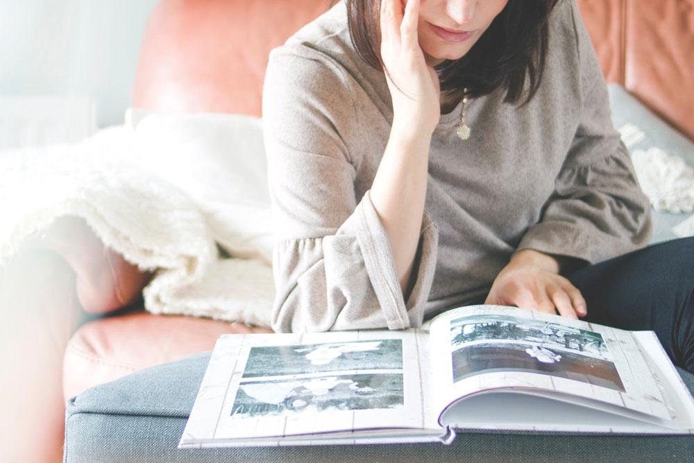Woman looking at a photo book