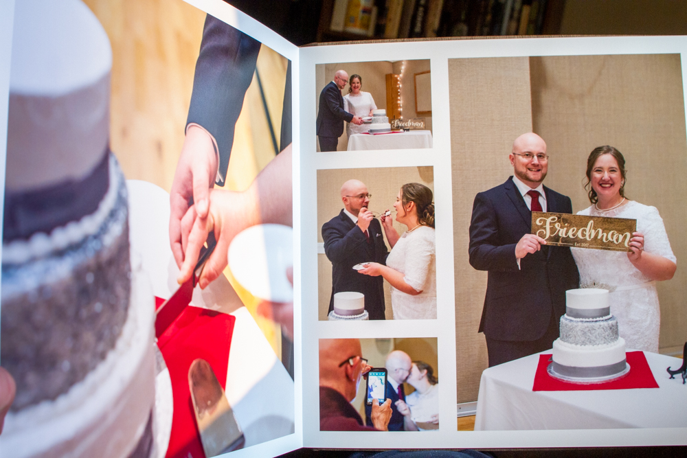 Photo book layout with pictures of a bride and groom cutting their cake