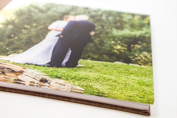 Photo book cover featuring an image of a bride and groom under a layer of clear acrylic