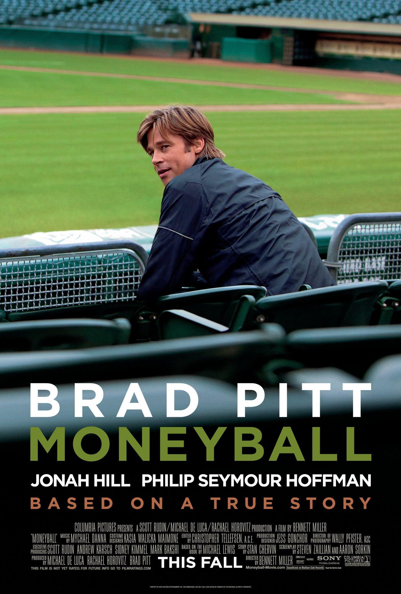 Moneyball poster with Brad Pitt sitting in an empty baseball stadium