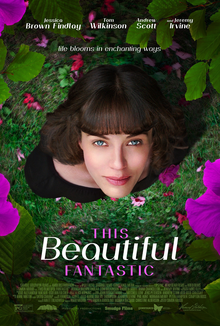 This Beautiful Fantastic movie poster, featuring a young woman looking up from between bright pink flowers